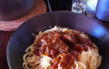 Pastitsada (Spicy Rooster or Beef with spaghetti in tomato sauce)
