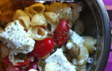 Greek salad with olives and lumaconi rigati
